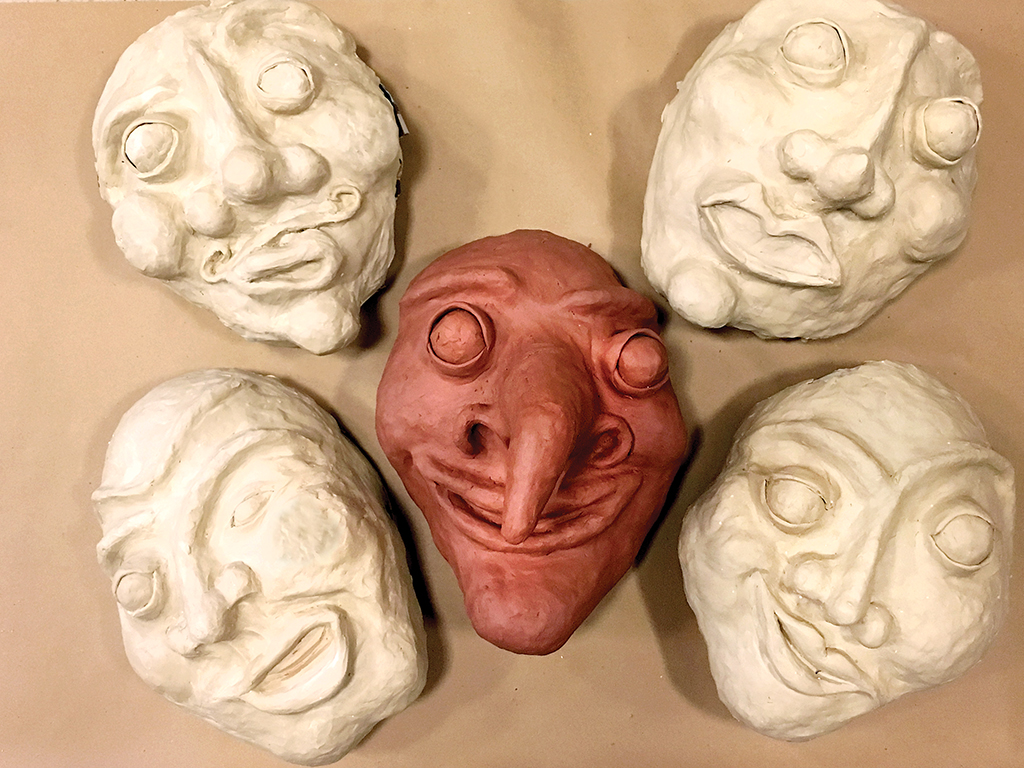 The five character faces, sculpted and ready to be papier-mached, sanded, and painted.