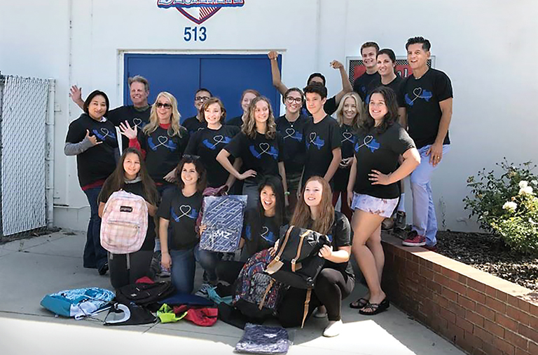 Thespians at Los Alamitos High School show off the T-shirts they designed to raise money for Kingwood High Thespians.