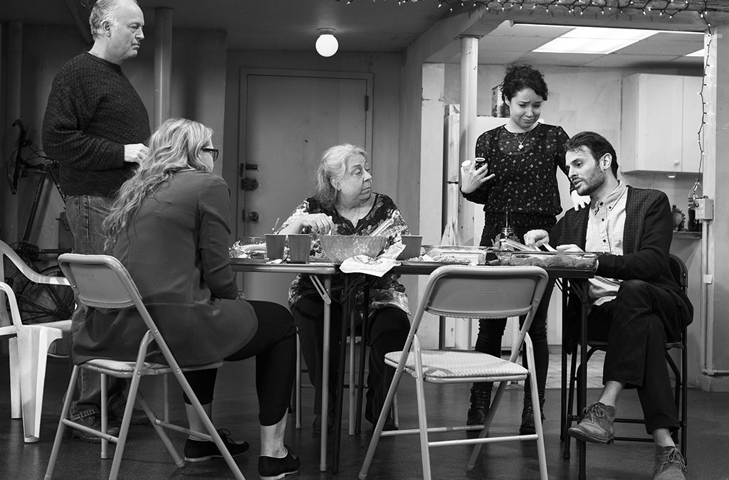 Jayne Houdyshell (seated at center) with Reed Birney, Cassie Beck, Sarah Steele, and Arian Moayed in the Broadway production of The Humans.