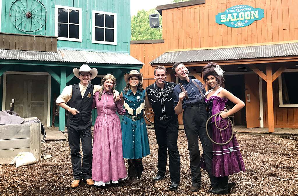 Thespian alum Evan Benjamin (second from right) with cast members from a summer children's show at Idlewild theme park.