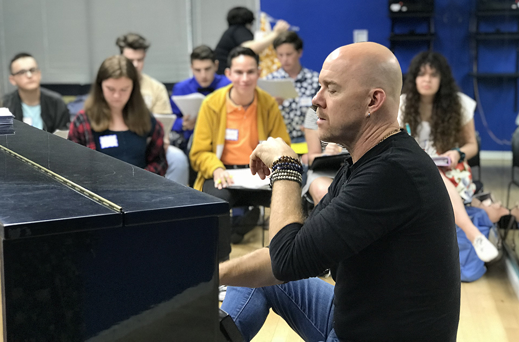 Music director Todd Schroeder rehearses the California Thespian cast.