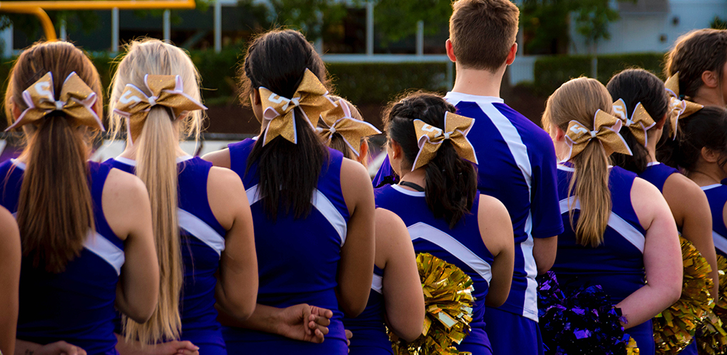 Group of male and female cheerleaders.