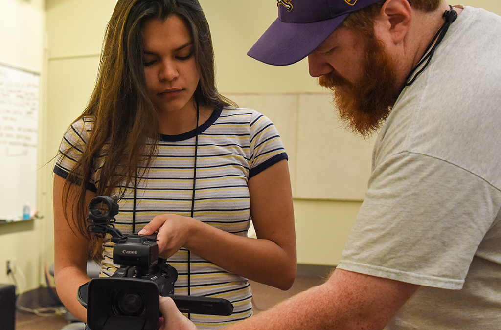 A Thespian Filmworks student practices using a camera during the 2018 International Thespian Festival.