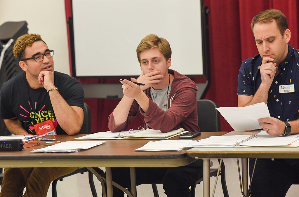 Music director Marques Higgins, playwright Mitchell Huntley, and director Brian Curl attend auditions for the staged reading of How to Get a 5 on the AP Test at the 2018 International Thespian Festival.
