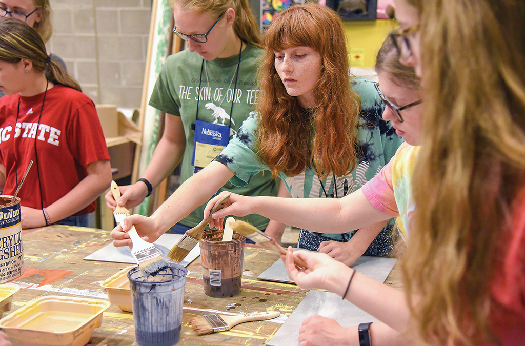Students learn painting techniques.