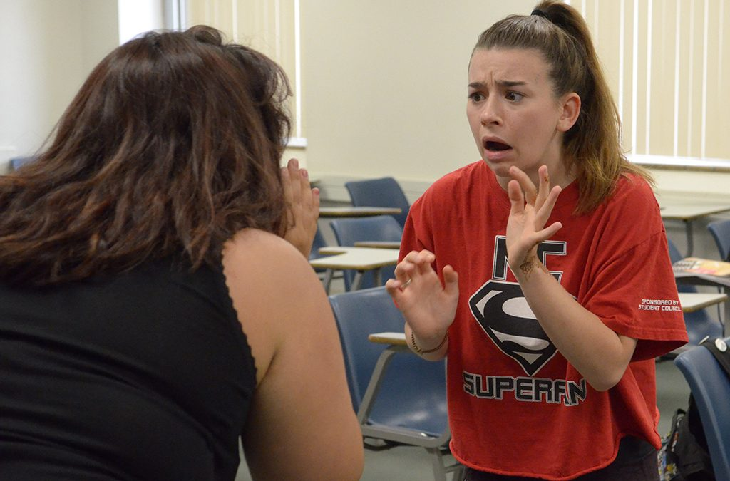 Two students improv a scene during a 2015 ITF workshop.