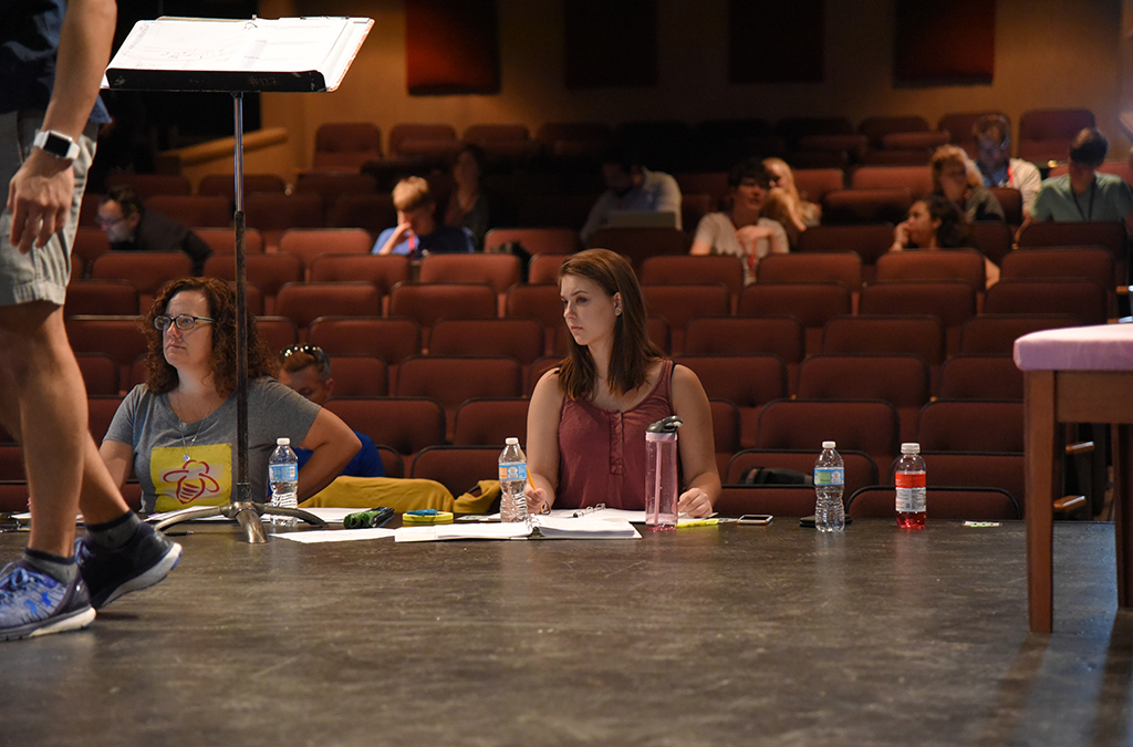 A student stage manager takes notes during rehearsals for the opening show of the 2017 International Thespian Festival.