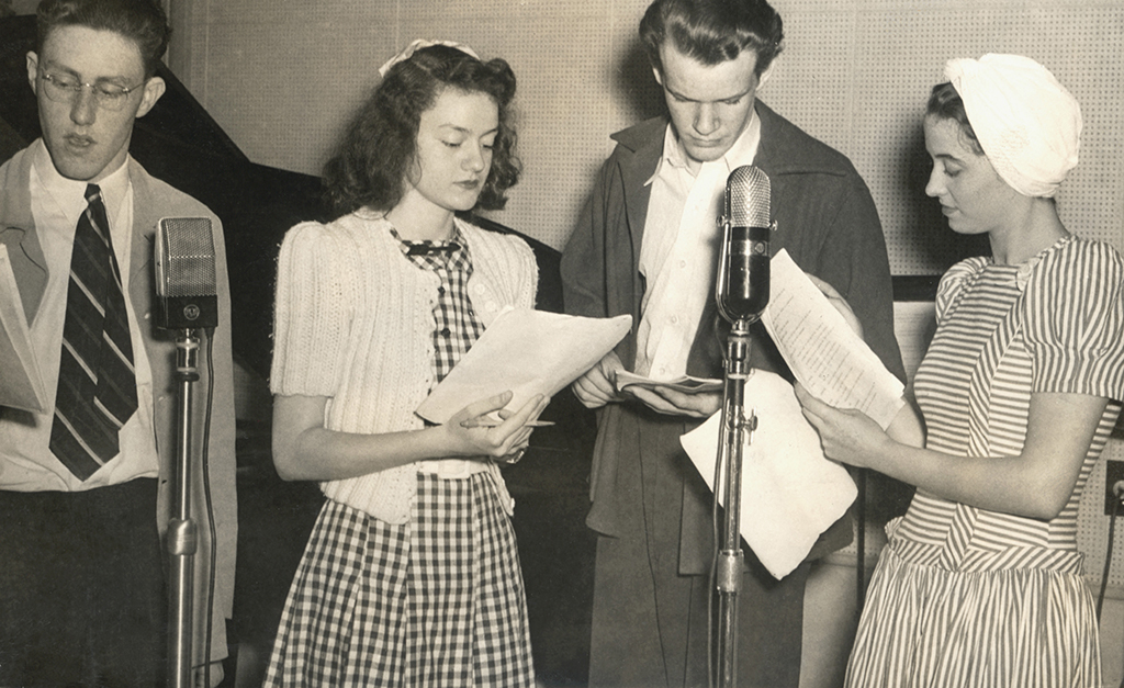 Students participate in a coast-to-coast radio broadcast at the first Thespian conference.