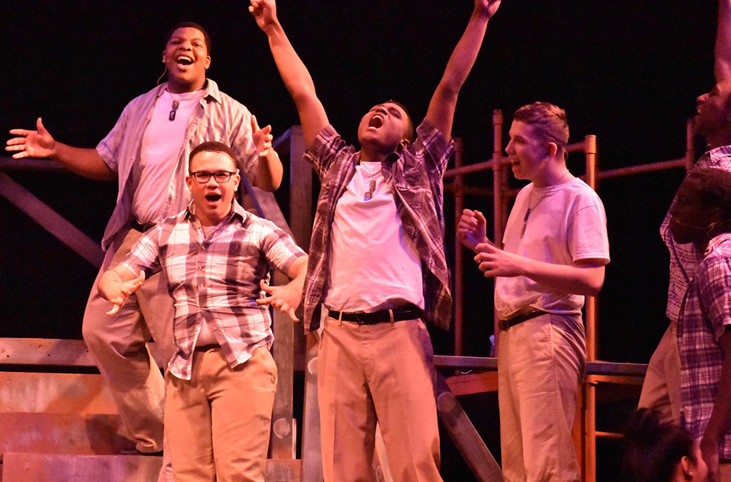 Corbin Griffin, Jabari Williams, Raymond Butler, and Matt Buss in Benson High School's production of Dogfight.
