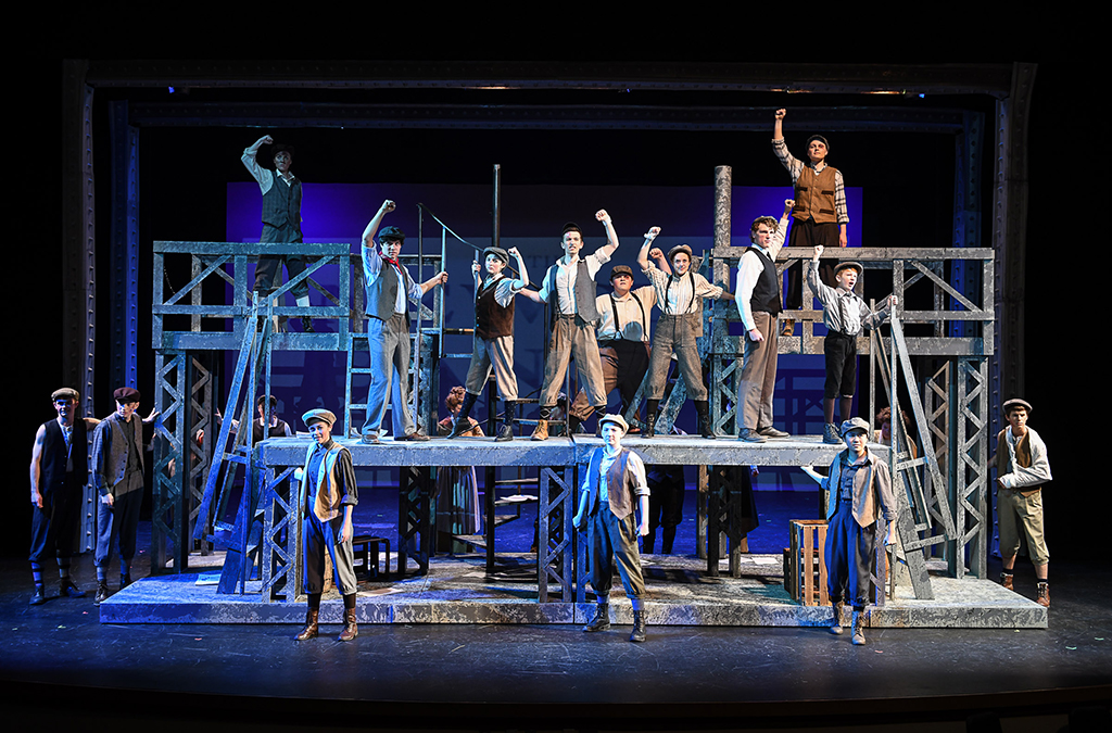 The cast of Lewis and Clark High School's production of Newsies.