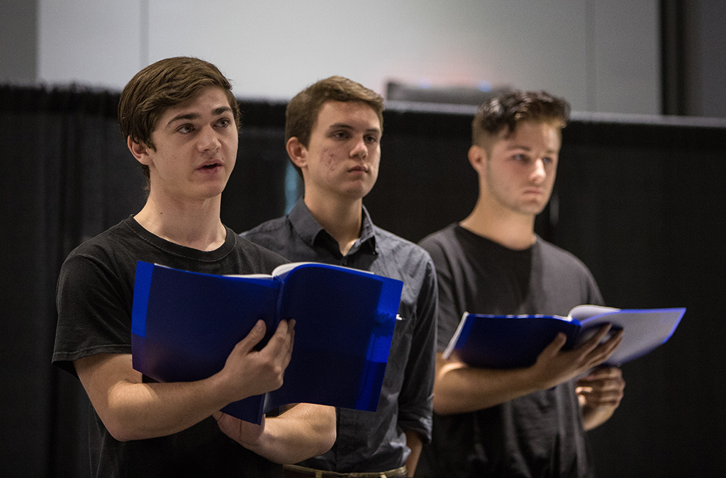 John Eddy, Shane Howell, and Parker Medley perform in the 2018 International Thespian Festival staged reading of Umtya.