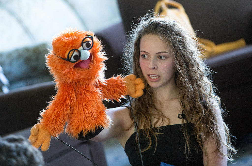 A Thespian tests newfound puppetry skills during a workshop session.