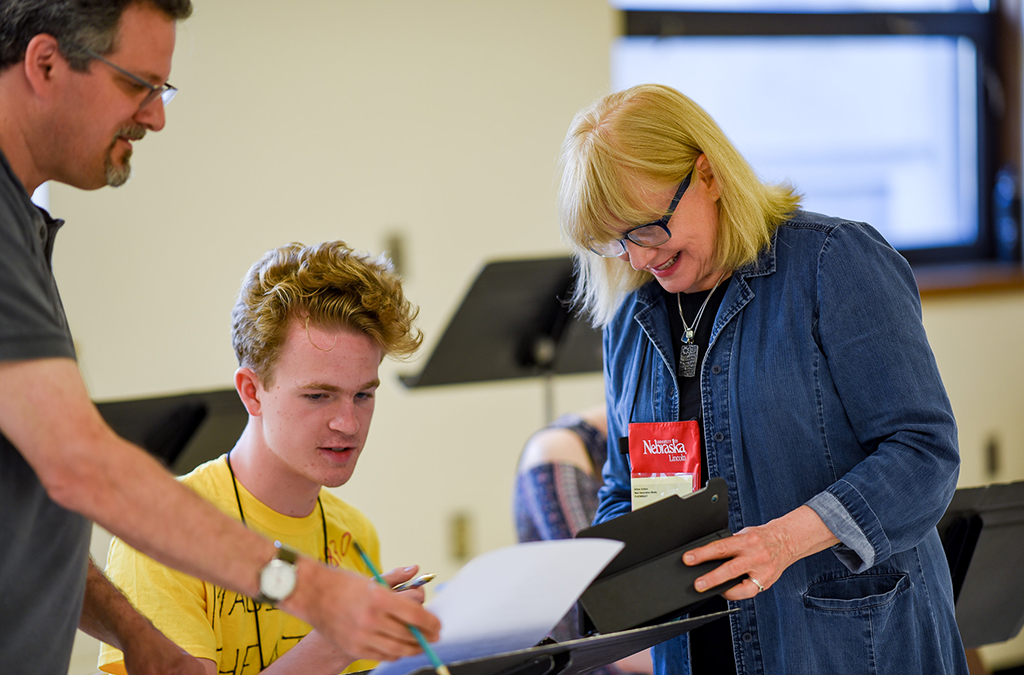 Playwright Arlene Hutton (right) works with a student during rehearsals for her commissioned play, Susie Sits Shiva.