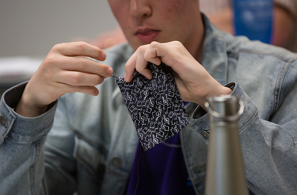 Costuming students learn key sewing skills in a workshop.