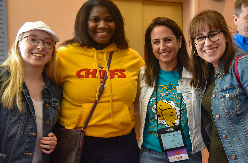 Educational Theatre Association Executive Director Julie Cohen Theobald (second from right) greets early registrants.