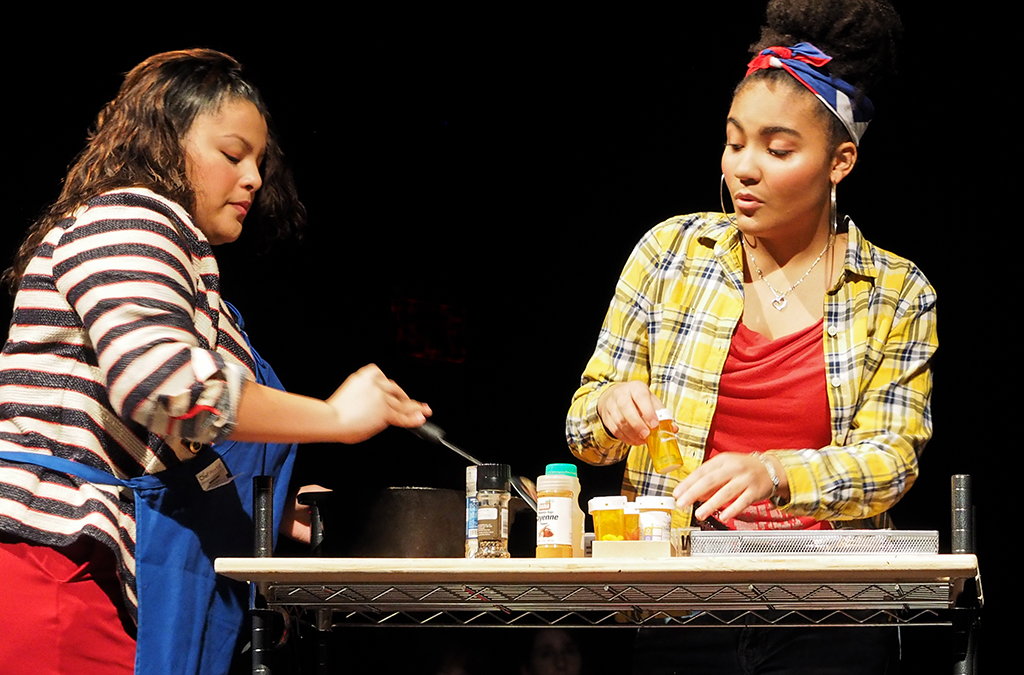 Tatiana Pineda and Vivian Santos-Smith in Somerville High School's production of Holy Broth.