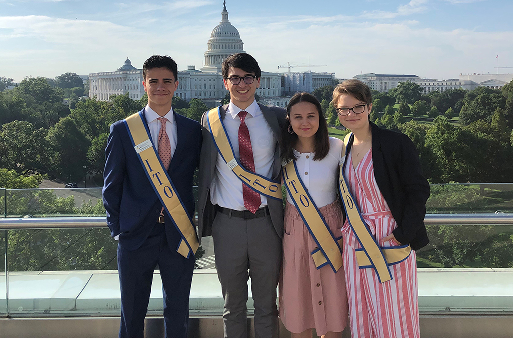 Nic Fallacaro, Keith Peacock, Abby Stuckrath, and Maura Toole in front of the U.S. Capitol.