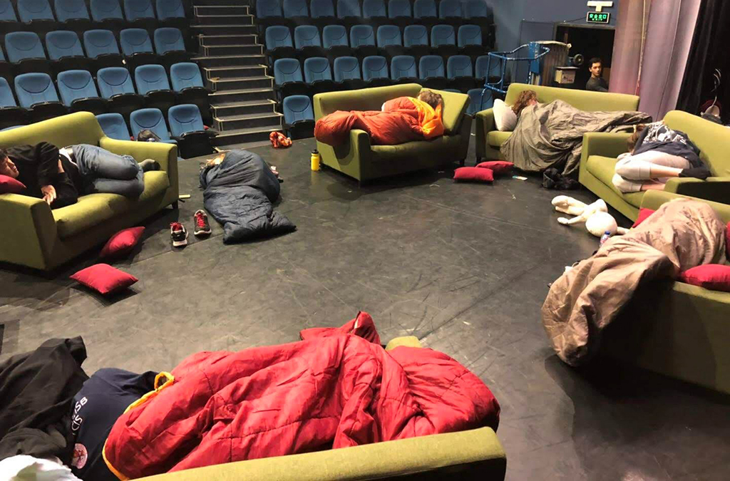 Western Academy of Beijing Thespians catch a few precious hours of sleep in an onstage couch circle during their 24-hour theatre event.