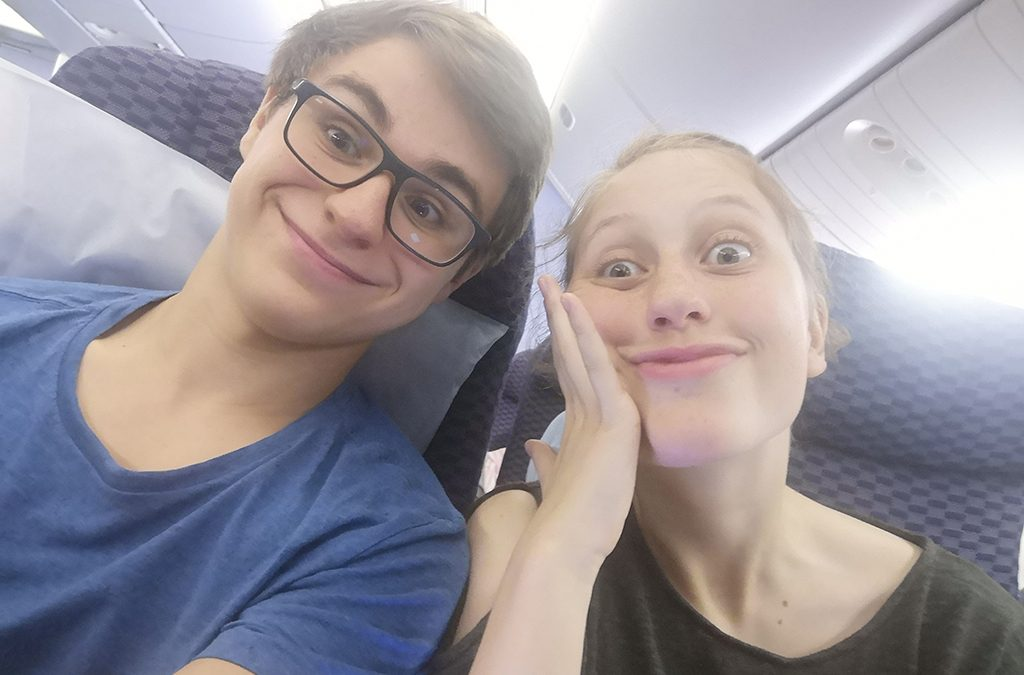 Exhibit B: The author and Thespian troupe president Anna McClanahan during their 19-hour flight to the 2019 International Thespian Festival. The flight was still fun until this point.