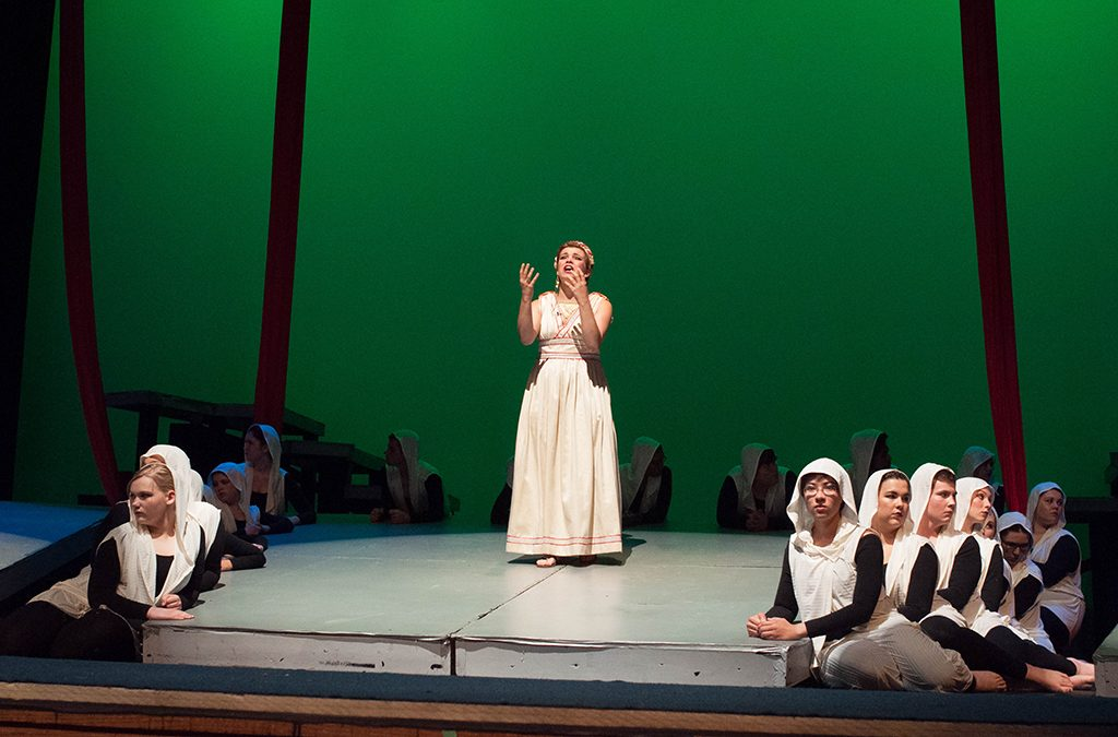 Antigone seeks justice for both her brothers in New Albany (Ind.) High School's 2014 International Thespian Festival production of Antigone.