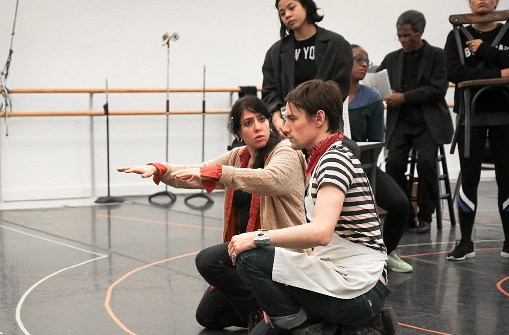 Director Rachel Chavkin (left) in rehearsal for Hadestown with Reeve Carney and Eva Noblezada.