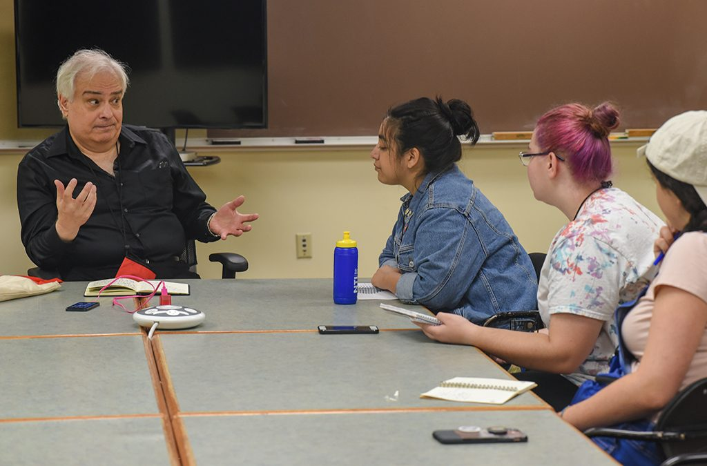 Peter Filichia works with up-and-coming arts journalists during the Thespian Criticworks program at the 2018 International Thespian Festival.
