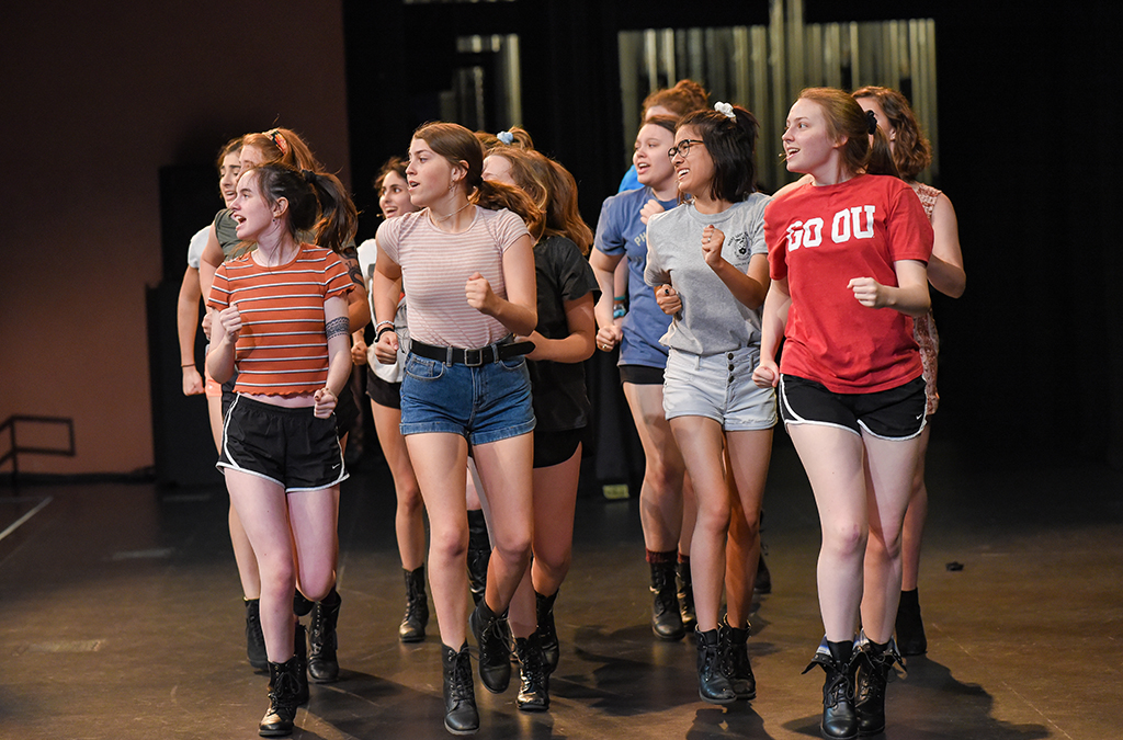 Thespians rehearse their number from the 2019 Opening Show.