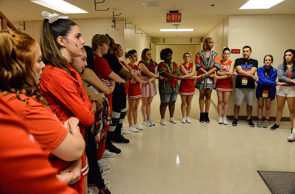 Kansas Thespians circle up one last time before hitting the stage in Bring It On.