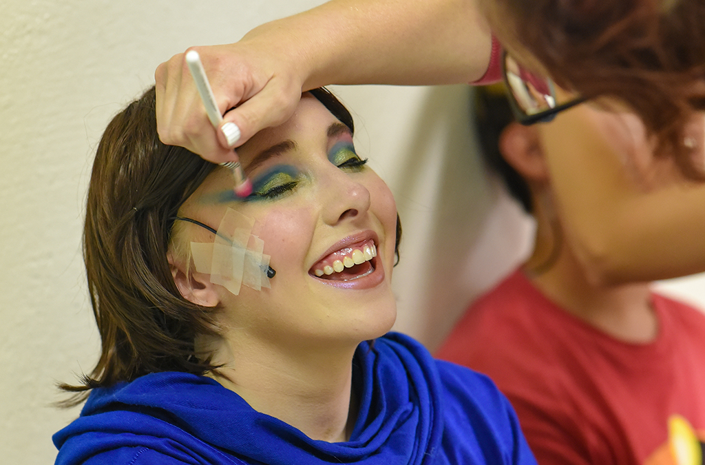 Cast members of St. Charles (Mo.) High School's production of She Kills Monsters undergo final makeup application.