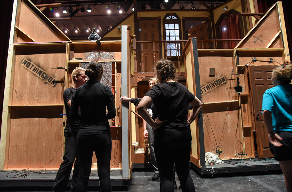 Running crew members from McPherson (Kan.) High School load in the set for their production of Noises Off.