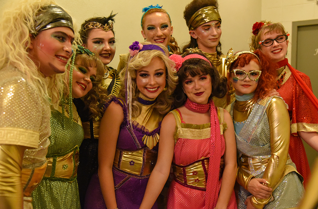 The cast of Arab (Ala.) High School's production of Xanadu enjoy a quiet moment before their show.
