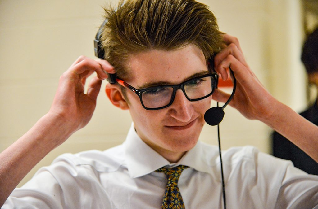 Theatre student wearing headset