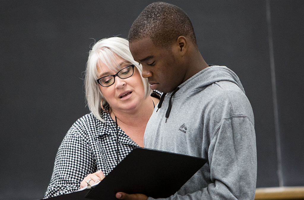 Director Carolyn Greer and actor Bryson Schultz in rehearsal for All Things Considered.