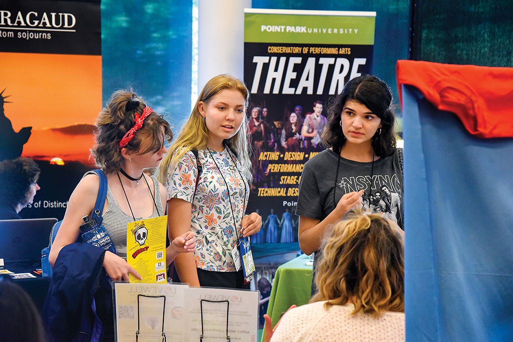 Thespians talk to representatives from college programs and theatre-related companies during ITF.