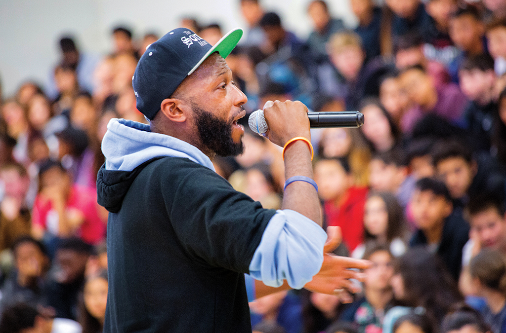 As The Sonnet Man, Devon Glover performs at a school assembly in conjunction with the 2019 Shakespeare in Yosemite/University of California, Merced production of As You Like It.