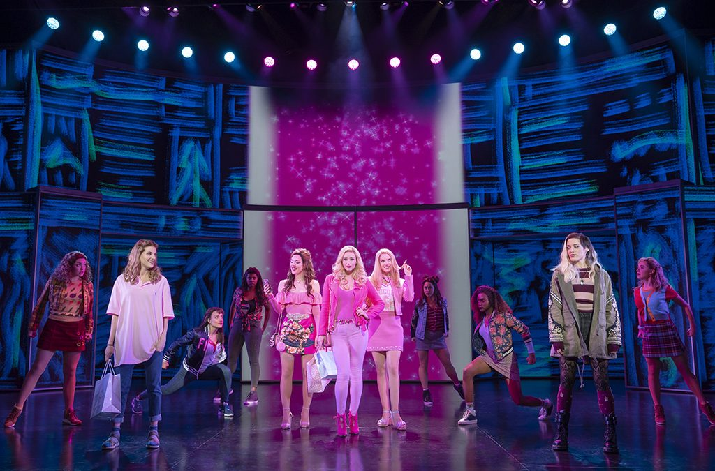 Projected backgrounds helped create rapid scene transitions in the national tour of Mean Girls.