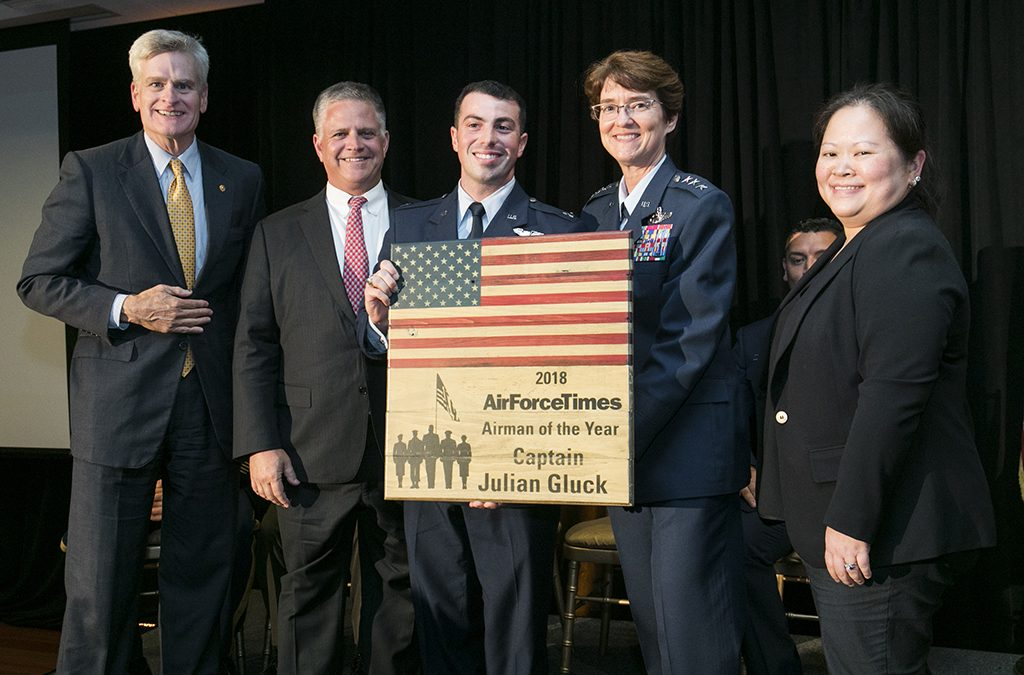 Senator Bill Cassidy, Congressman Drew Ferguson, Captain Julian Gluck, Lieutenant General Jacqueline Van Ovost, and Editor Michelle Tan as Gluck receives his Airman of the Year Award on July 11, 2018.