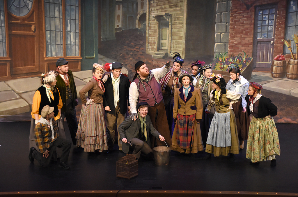 Matt Landon as Alfred P. Doolittle and the cast of the New Albany High School production of My Fair Lady.