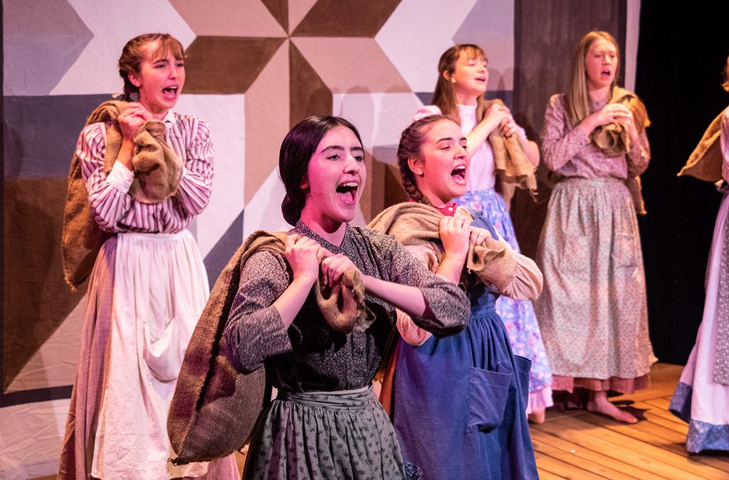The entire ensemble remains onstage throughout the Orange County School of the Arts production of Quilters.