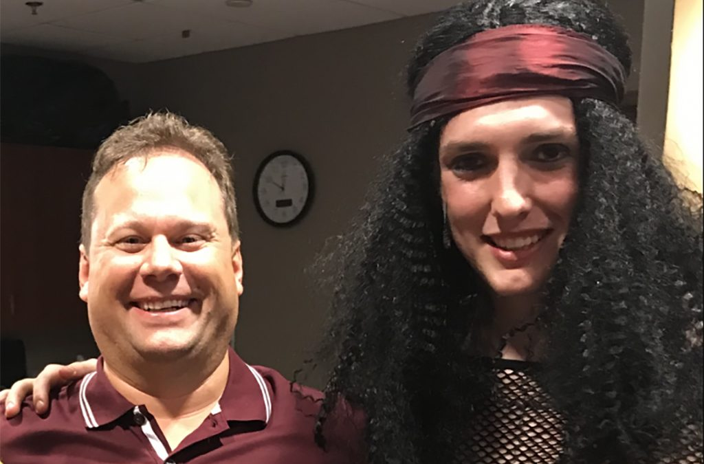 Spencer Angell (right) with Chad Nulik, his former troupe director, following a performance of Rock of Ages.