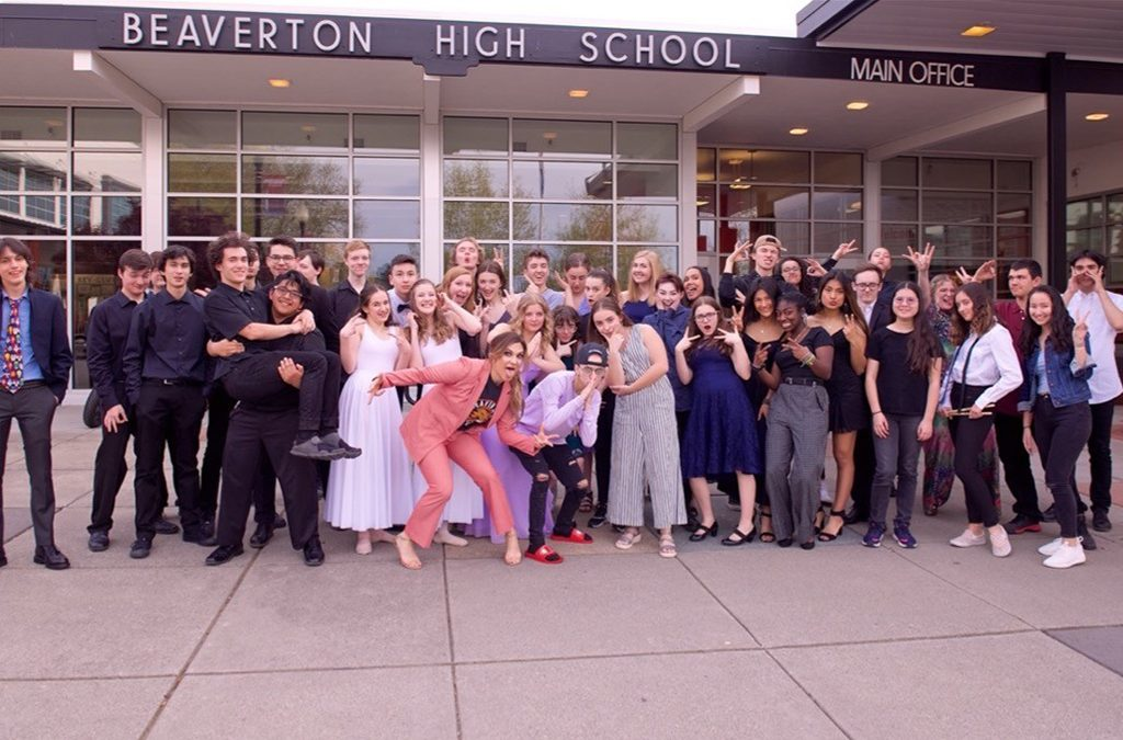 Shoshana Bean (front) with the student performers at her alma mater, Beaverton High School.