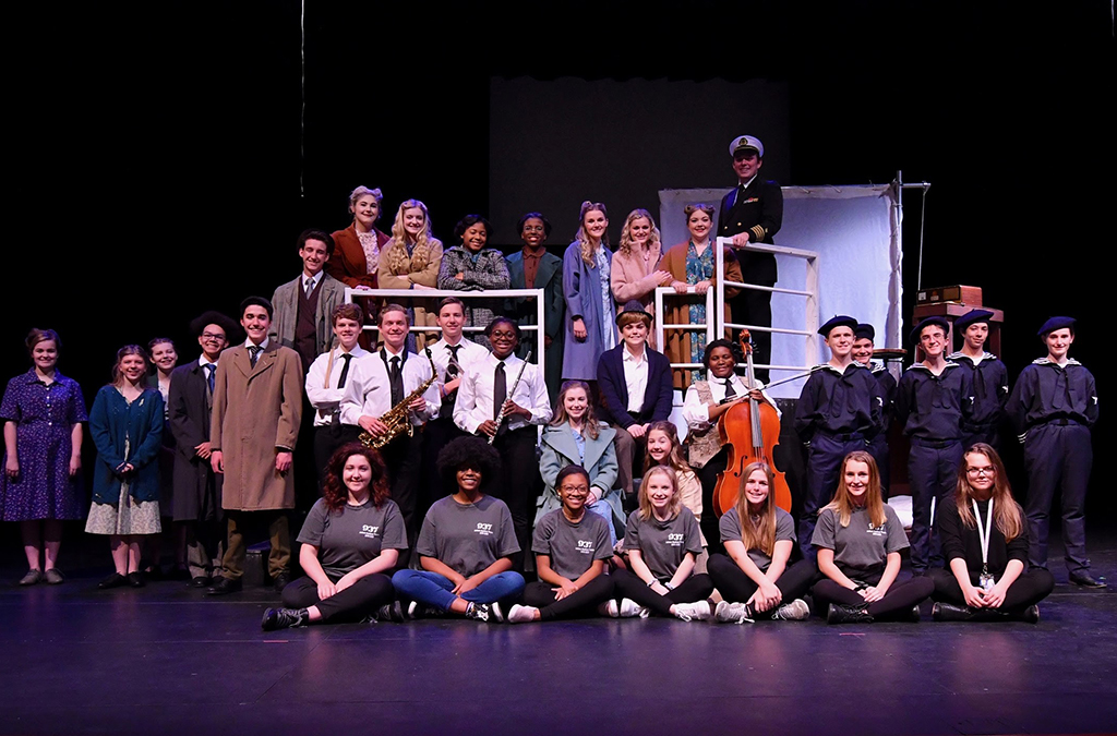 Caitlin Johnson (top middle) with the cast and crew of 937.