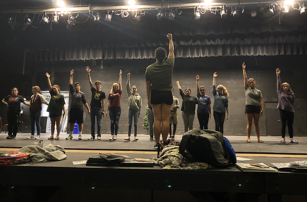 Sophia Hillman oversees a dance rehearsal as the director of Elf.