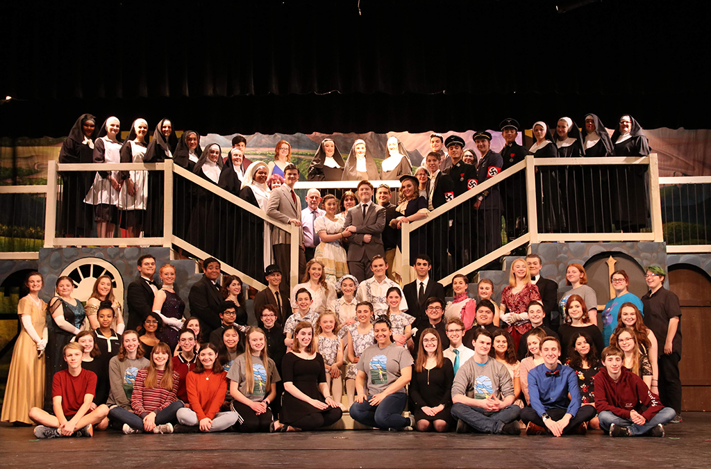 Sophia Hillman (front center, with the team for The Sound of Music, says directing is her second favorite theatre activity.