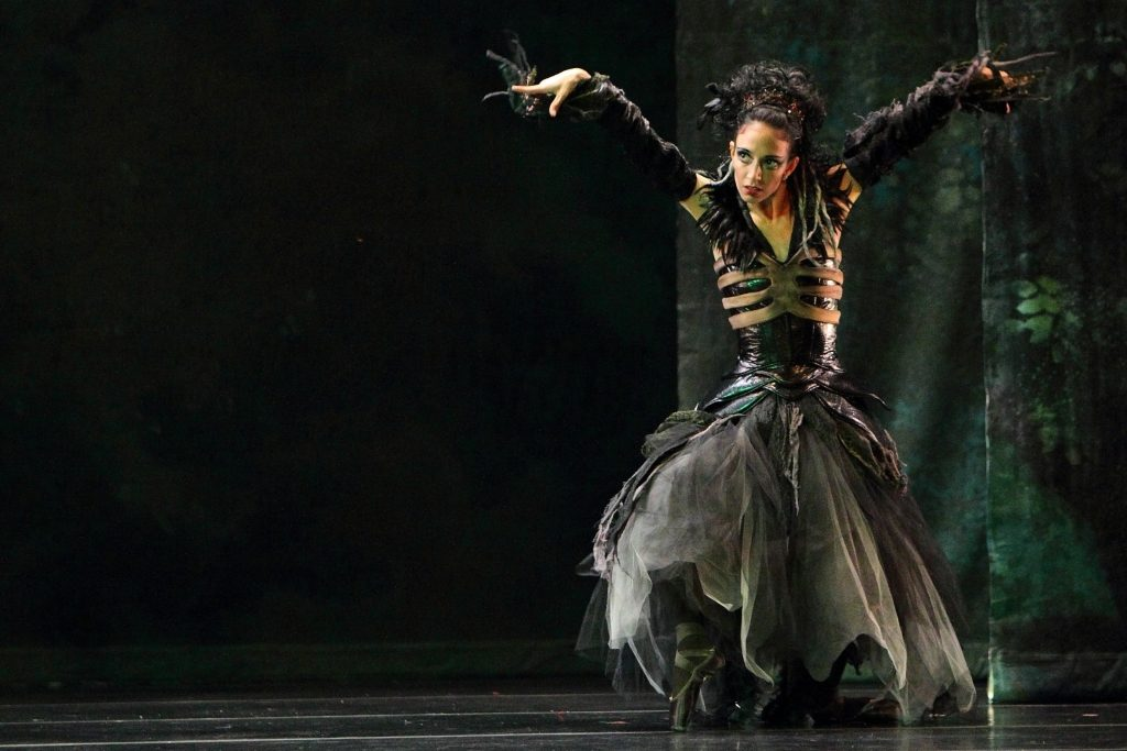 This shot of the Dayton Ballet's Dracula: Bloodlines illustrates toning. Emerald Green lighting pulls out the greens in the scenery and costumes. You can notice the green light on the dancer, but the unsaturated key lighting of the scene keeps her from appearing overly green. Lighting Design by the Joe Beumer. Photo by Geek with a Lens Photography.