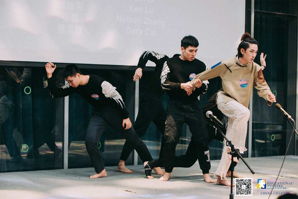 Five young Asian male students rehearing a play