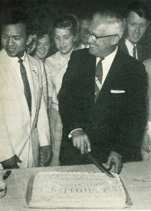 Leon C. Miller cuts the congratulatory cake.