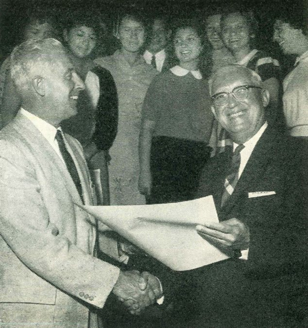Mr. Carl MacDonald, principal of Monterey Union High School, accepts Charter 2000 from Leon C. Miller, executive secretary of the National Thespian Society.