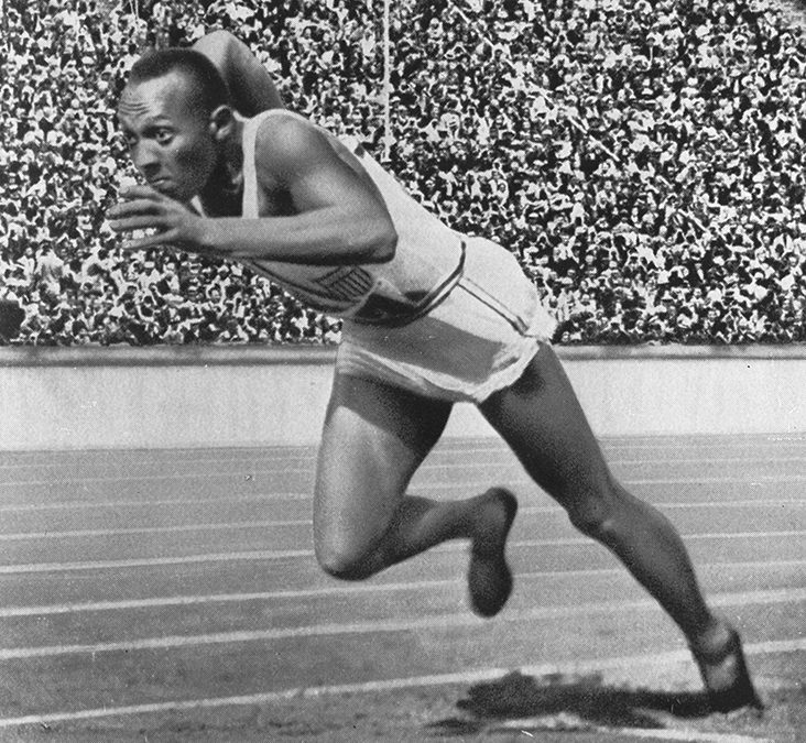 1936: Jesse Owens wins four gold medals at the Berlin Olympics.