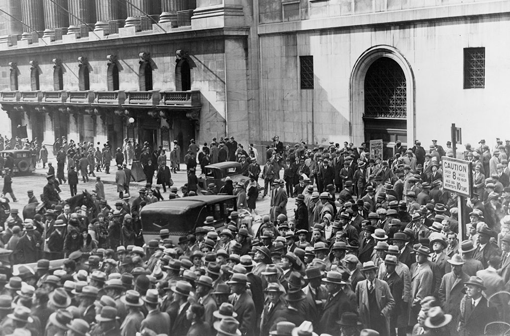 A crowd gathers outside the New York Stock Exchange following the U.S. stock market crash.